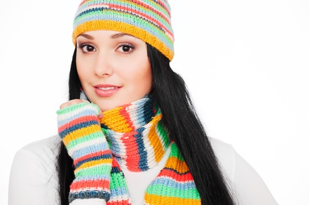 portrait of smiley woman in striped hat and scarf. isolated on white background  photo