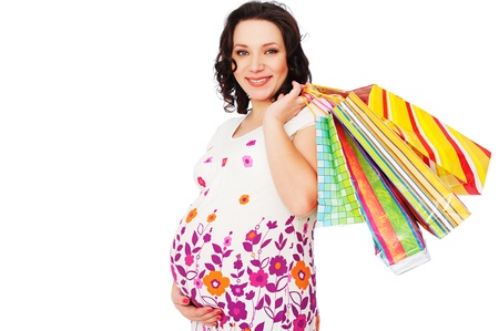 smiley pregnant woman holding shopping bags. isolated on white Stock Photo - 8984511