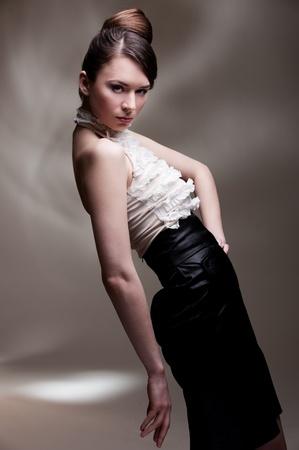 portrait of stylish model over grey background  photo
