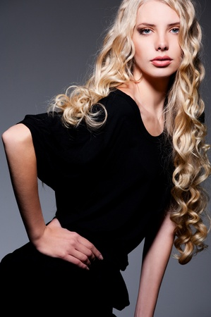 portrait of alluring blonde with long curly hair Stock Photo - 9145731