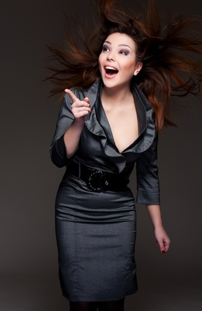 portrait of attractive young woman pointing her finger photo