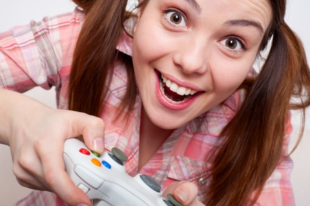 joyous young woman playing video game  photo