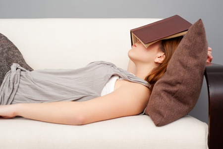 sleeping woman: woman sleeping with book on her face