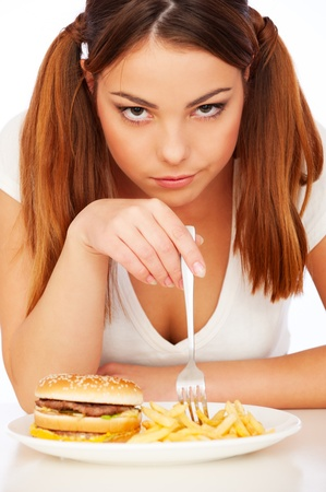 disinclination: portrait of woman with burger and deep-fried potatoes