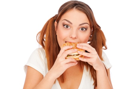 overeat: portrait of woman with burger. isolated on white