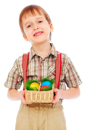 portrait of pretty smiley boy with Easter colorful eggs  photo