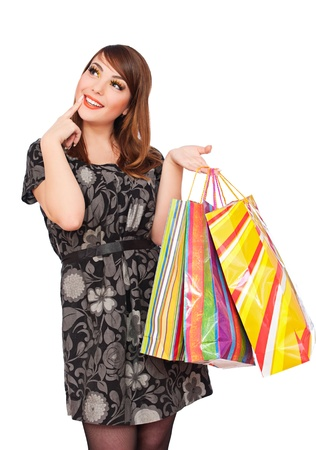 portrait of smiley pensive woman holding shopping bags  photo