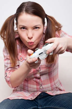 young woman playing video game  photo