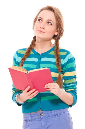 pretty woman with book looking up over white background photo