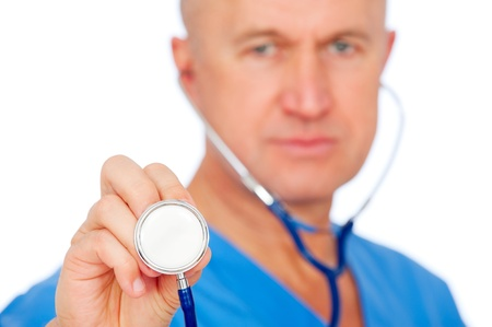 close-up portrait of doctor with stethoscope over white background. focus on stethoscope  photo
