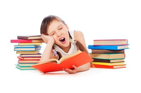 slumberous: portrait of drowsy little girl with books Stock Photo