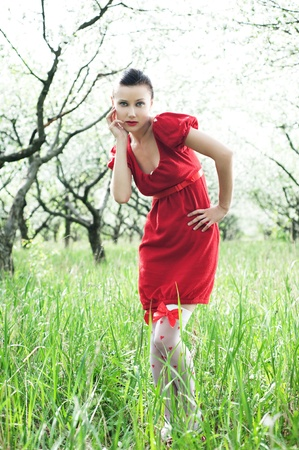 outdoor portrait of beautiful woman in red dress  photo