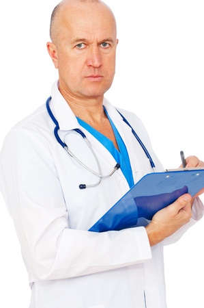serious doctor writing report over white background  photo