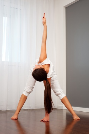 portrait of woman doing flexibility exercise Stock Photo - 9267925