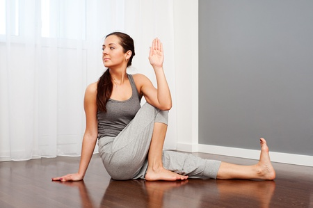 flexible: portrait of young woman doing flexibility yoga exercise Stock Photo
