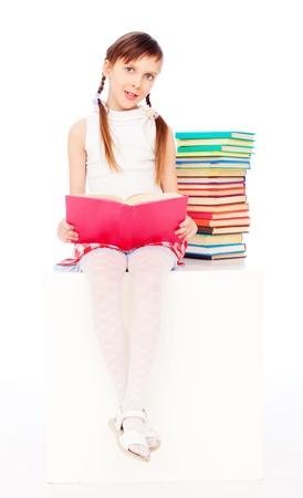 portrait of cute smiley girl with books photo