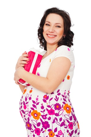 portrait of smiley pregnant woman with gift box photo