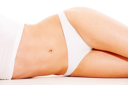 piernas mujer: cuerpo de la mujer hermosa en ropa interior blanco  Foto de archivo