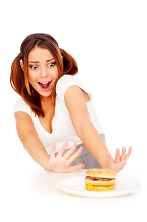 disinclination: portrait of emotional woman with burger. isolated on white background