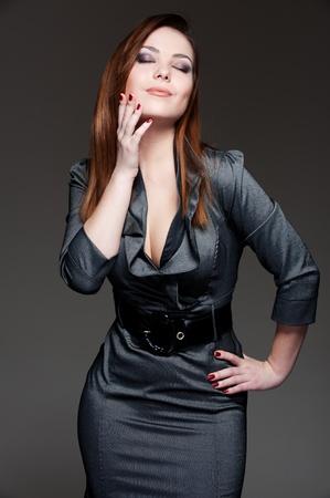 portrait of beautiful woman in dark dress  photo