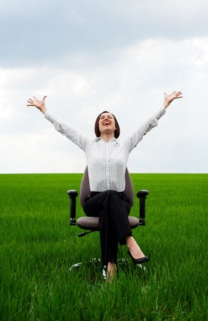 recliner: happy businesswoman sitting on recliner over green meadow