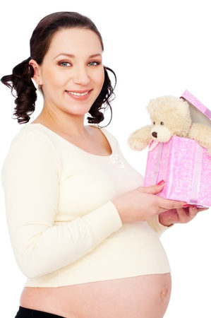 portrait of pregnant woman with toy. isolated on white background photo