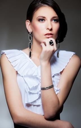 portrait of alluring brunette over dark background Stock Photo - 9763989