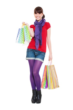 cheerful young woman with shopping bags against white background Stock Photo - 9760304