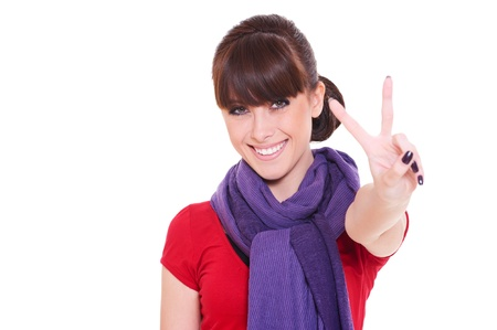 pretty happy woman giving peace sign. isolated on white background photo