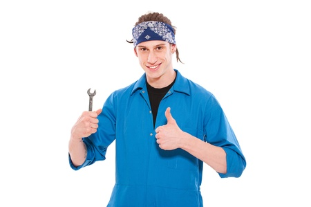 mechanician: smiley handyman holding screw key and showing thumbs up. isolated on white background