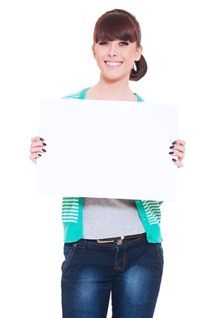 portrait of attractive smiley woman holding empty blank against white background  photo