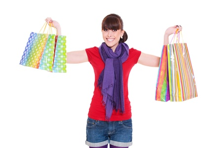 happy young woman with shopping bags against white background photo
