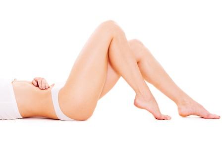 lovely feminine legs over white background  photo