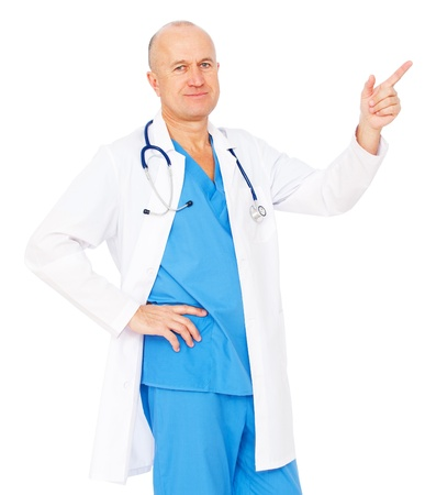 portrait of smiley medical doctor pointing at something. isolated on white background photo