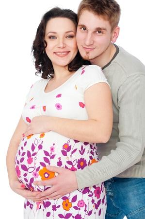 echtgenoot: Portret van lachende jonge zwangere vrouw met haar man naast haar
