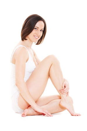 white panties: attractive smiley young woman in white underwear  Stock Photo