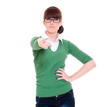 stern: earnest woman in glasses pointing. isolated on white background