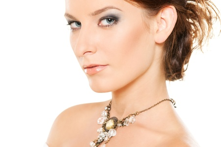 portrait of attractive woman with jewellery on her neck photo