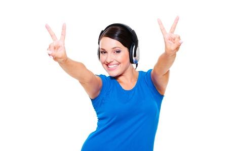 happy pretty model in headphones posing over white background photo