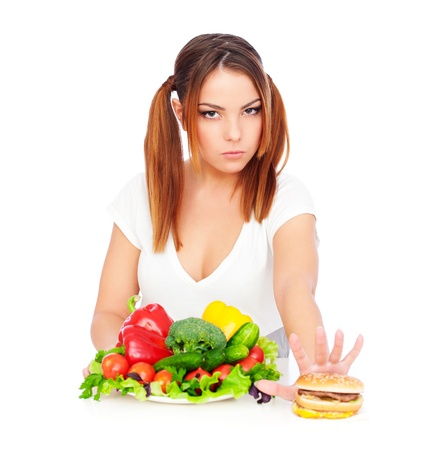 serious woman don't want to eat junk food. isolated on white background  Stock Photo - 9998735