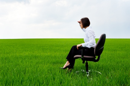 recliner: serious businesswoman looking forward and having put her palm to forehead