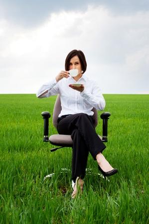 portrait of businesswoman with white cup of coffee photo