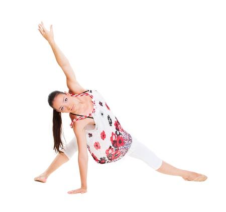 danza contemporanea: retrato de la bailarina flexible sobre fondo blanco Foto de archivo