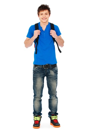teenage boy: smiley guy in blue t-shirt and jeans. isolated on white background