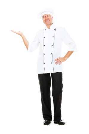 full-length portrait of cheerful chef holding something on his palm. isolated on white background  photo