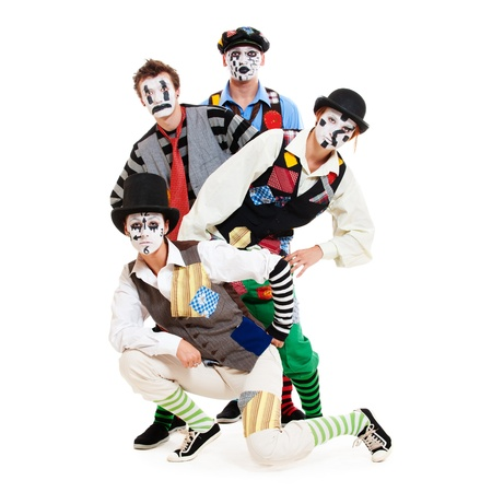 stage actors: portrait of motley mimes. isolated on white background