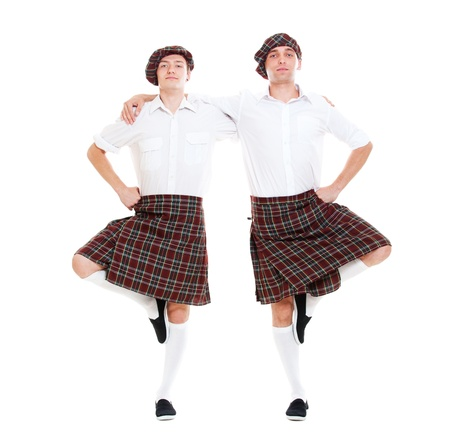 scot: portrait of two scottish dancers. isolated on white background