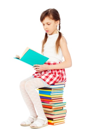obedient: portrait of pretty girl with books. isolated on white background