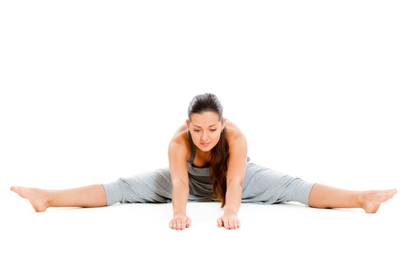 pretty woman doing flexibility exercise. isolated on white background photo