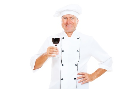 portrait of smiley chef holding glass of red wine. isolated on white background  photo